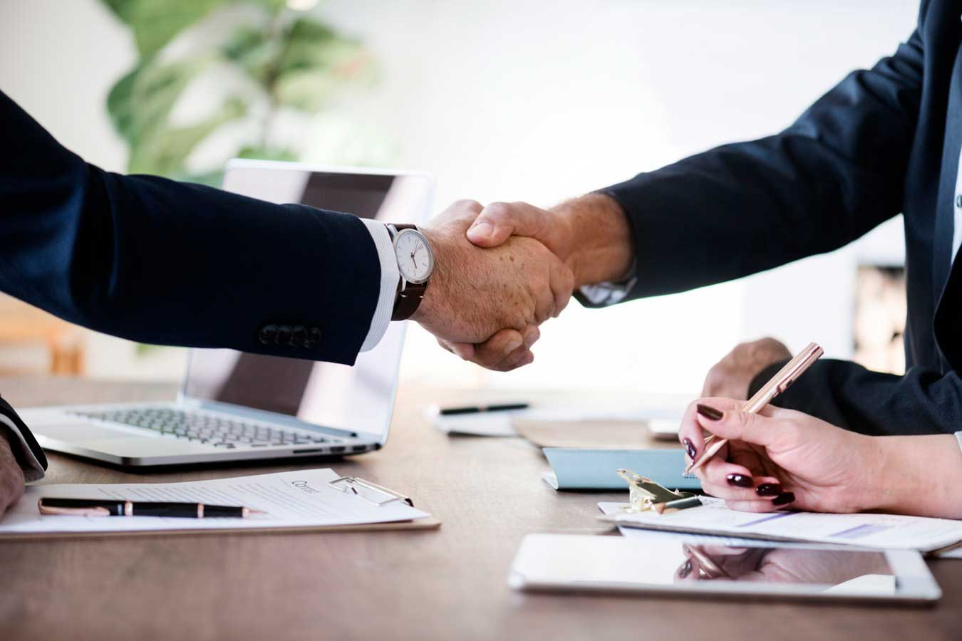 People Shaking Hands Making A Deal